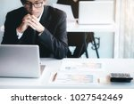 businessman using computer to... | Shutterstock . vector #1027542469
