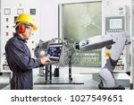engineer using laptop computer... | Shutterstock . vector #1027549651