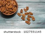 Pecan Nuts On Wooden Backgroun...