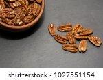 tasty pecan  in wooden bowl on... | Shutterstock . vector #1027551154