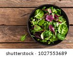 fresh salad mix of baby spinach ... | Shutterstock . vector #1027553689