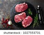 raw beef meat. fresh steaks on... | Shutterstock . vector #1027553731