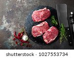 raw beef meat. fresh steaks on... | Shutterstock . vector #1027553734