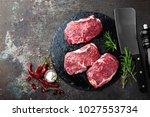 raw beef meat. fresh steaks on... | Shutterstock . vector #1027553734