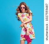 gorgeous fashion blond woman ... | Shutterstock . vector #1027555687