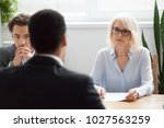 serious attentive senior female ... | Shutterstock . vector #1027563259