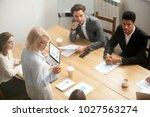 serious mature woman team... | Shutterstock . vector #1027563274