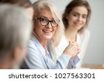 Smiling aged businesswoman in...
