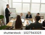 female team leader or... | Shutterstock . vector #1027563325