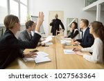 businesswoman raising hand up... | Shutterstock . vector #1027563364