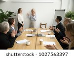 senior woman boss introducing... | Shutterstock . vector #1027563397