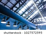 industrial warehouse interior... | Shutterstock . vector #1027572595