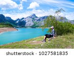 man on the lake shore in the... | Shutterstock . vector #1027581835