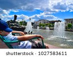 sunbathing in park by the... | Shutterstock . vector #1027583611