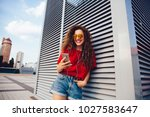 happy attractive young woman in ... | Shutterstock . vector #1027583647