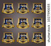 set of gold anniversary badges... | Shutterstock .eps vector #1027590055