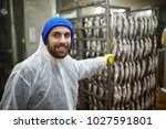 happy young staff in coveralls... | Shutterstock . vector #1027591801