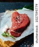 raw beef meat on a wooden... | Shutterstock . vector #1027595779