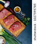 raw beef meat on a wooden... | Shutterstock . vector #1027595785