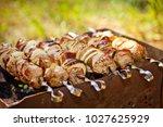 bbq meat prepare on fire  | Shutterstock . vector #1027625929