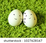 funny easter eggs on a green... | Shutterstock . vector #1027628167