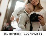 young mother  holding tenderly... | Shutterstock . vector #1027642651