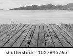 vintage wooden planked pier...   Shutterstock . vector #1027645765