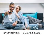 young couple sitting on the... | Shutterstock . vector #1027655101
