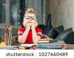 thinking child bored ... | Shutterstock . vector #1027660489