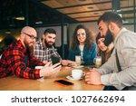 friends communicate in cafe... | Shutterstock . vector #1027662694