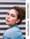 model in denim jacket on... | Shutterstock . vector #1027677691