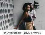 modern black man and caucasian...   Shutterstock . vector #1027679989