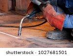 welder working at the factory ... | Shutterstock . vector #1027681501