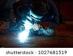 welder working at the factory ... | Shutterstock . vector #1027681519