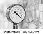 pressure gauge on a blurry... | Shutterstock . vector #1027682995
