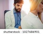 doctor examining patient with...   Shutterstock . vector #1027686901