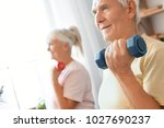senior couple exercise together ... | Shutterstock . vector #1027690237