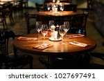 wooden table served with plates ... | Shutterstock . vector #1027697491
