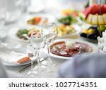 beautiful table set with three... | Shutterstock . vector #1027714351