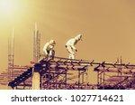 construction worker working on... | Shutterstock . vector #1027714621