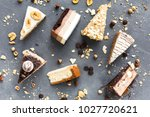assortment of pieces of cake on ... | Shutterstock . vector #1027720621
