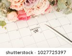 word wedding and two hearts on... | Shutterstock . vector #1027725397
