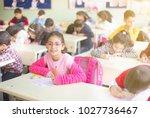 little girl student at the exam ... | Shutterstock . vector #1027736467