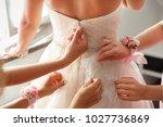 wedding help. hands of... | Shutterstock . vector #1027736869