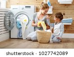 happy family mother housewife... | Shutterstock . vector #1027742089