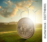 gold coin bitcoin against the... | Shutterstock . vector #1027748401