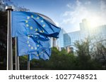 on the blue flag the symbol... | Shutterstock . vector #1027748521