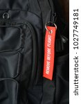 Small photo of Air travel. Remove before flight. A tag on the backpack.