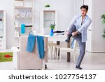 businessman late for office due ... | Shutterstock . vector #1027754137