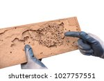 hand of a carpenter pointing at ... | Shutterstock . vector #1027757551